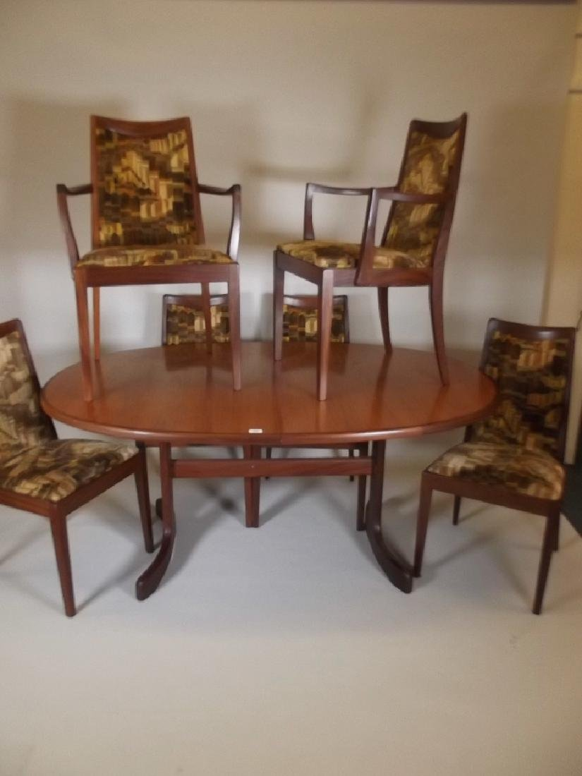 A G-Plan Fresco teak extending dining table, and six