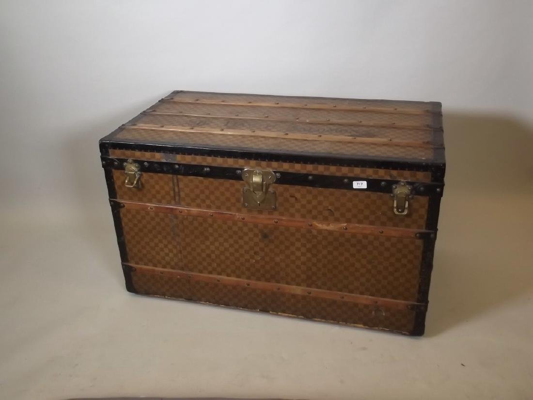 A Louis Vuitton metal strapped trunk with brass catches