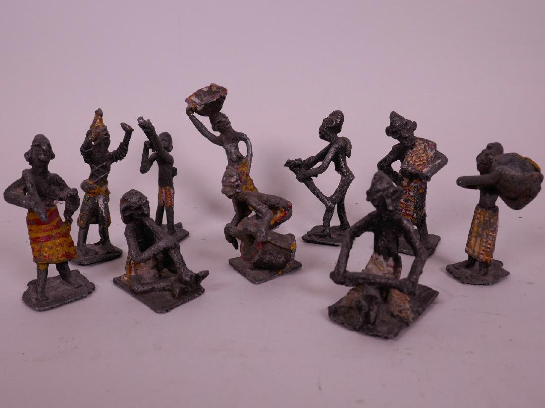 A collection of cold painted African metal figures, the