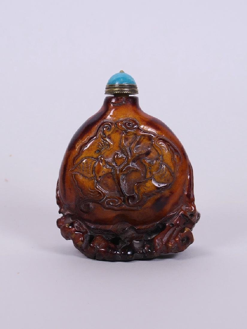 A Chinese carved deer horn snuff bottle in the form of