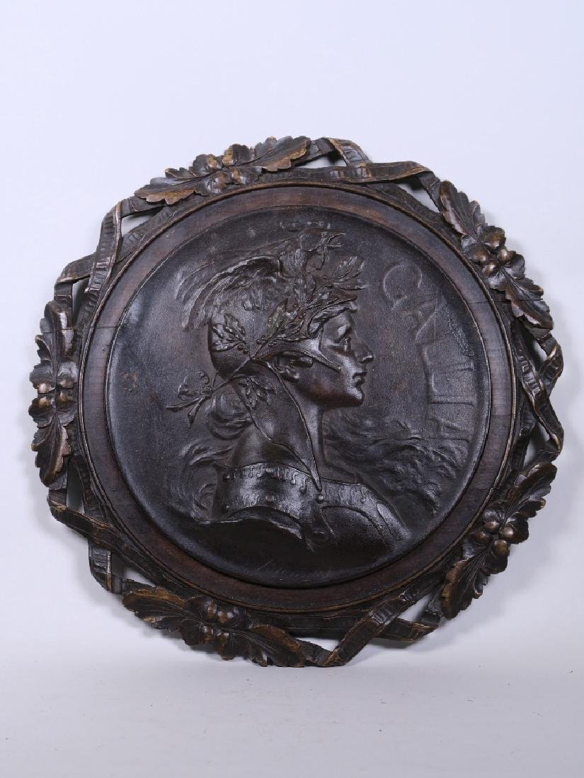 An embossed metal plaque profile of 'Gallia' in a