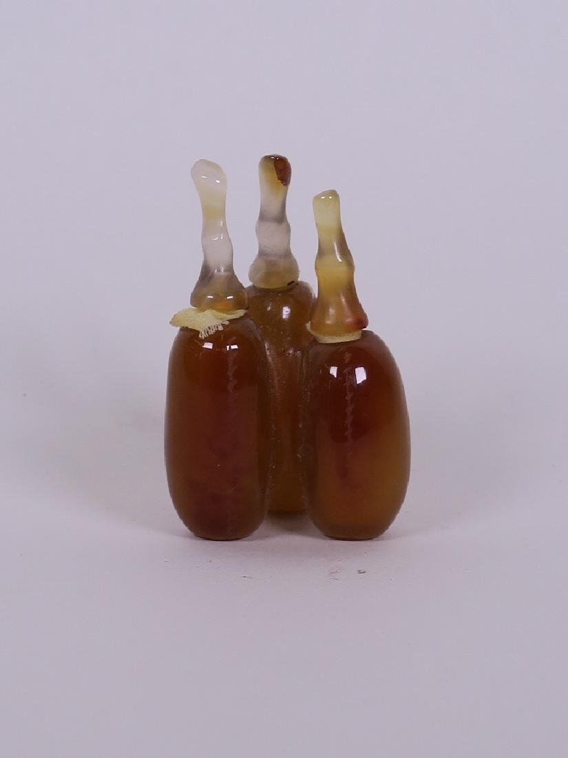 A Chinese three section agate scent bottle carved in