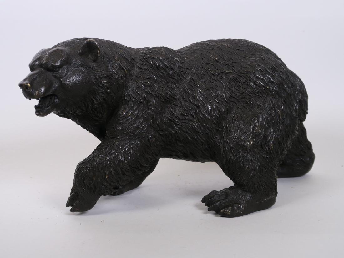 """A well cast bronze figurine of a brown bear, 8"""" high,"""