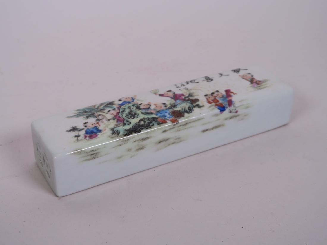 A Chinese polychrome porcelain wrist rest with