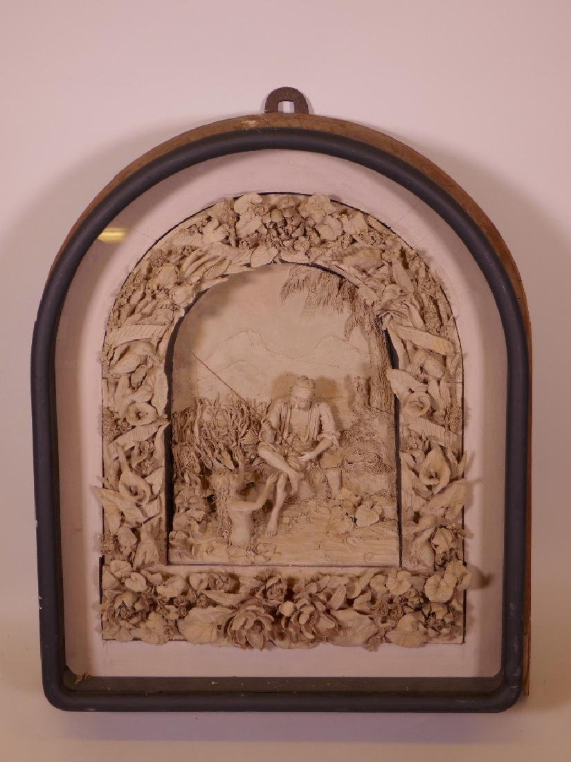 A C19th Continental terracotta plaque with finely