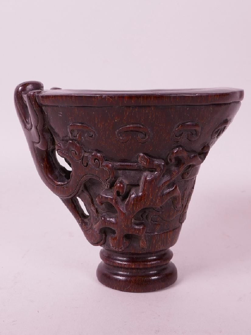 A Chinese faux horn libation cup with stylised kylin