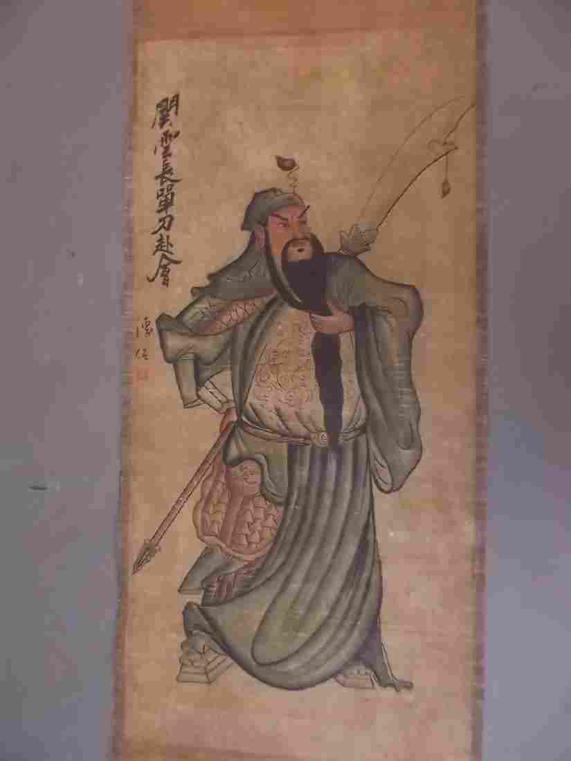 A Chinese scroll depicting a warrior, signed with