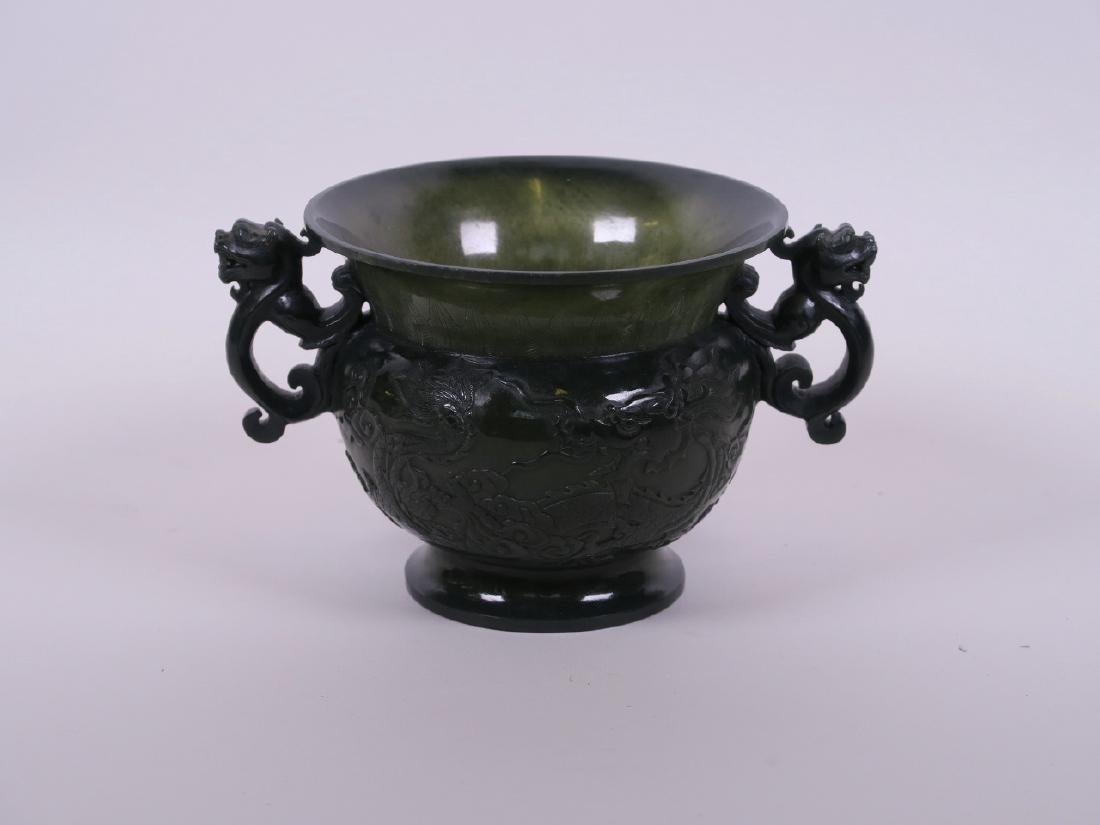 A fine Chinese spinach jade two handled pot with carved