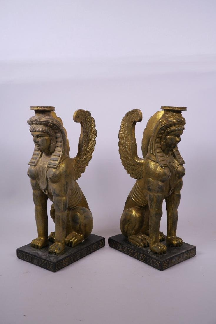 A pair of continental carved giltwood sphinx