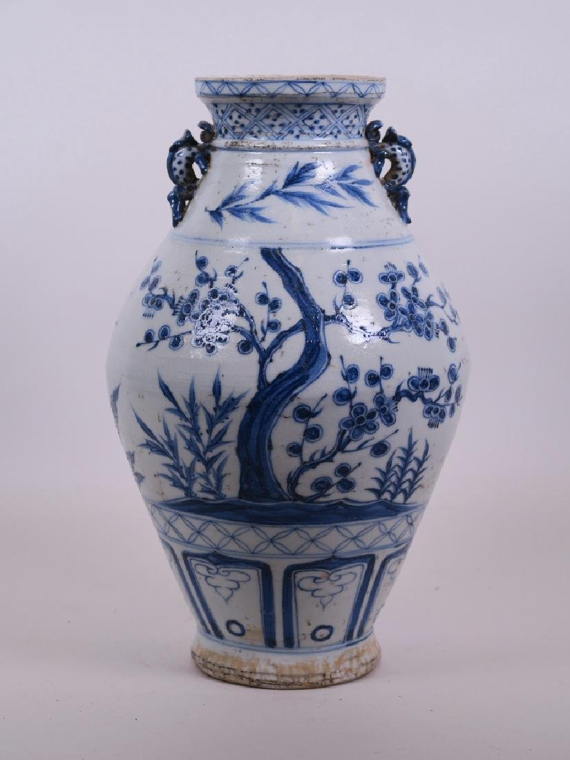 A Chinese Ming style blue and white pottery vase with
