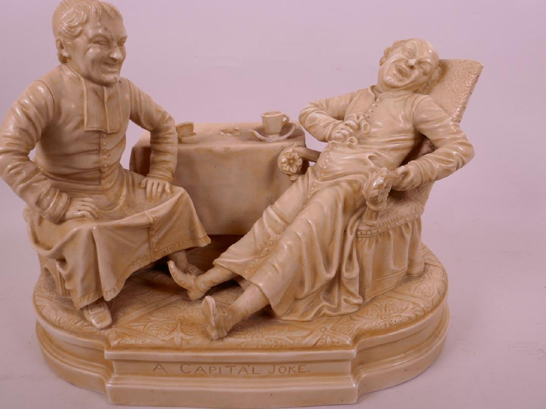 A C19th American porcelain figure group, two men seated