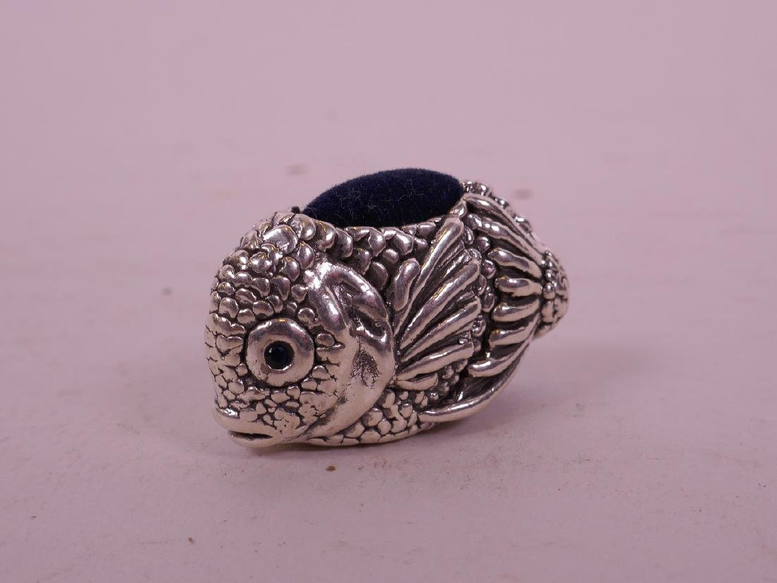 """A silver pin cushion in the form of a fish, 1 1/2"""" long"""