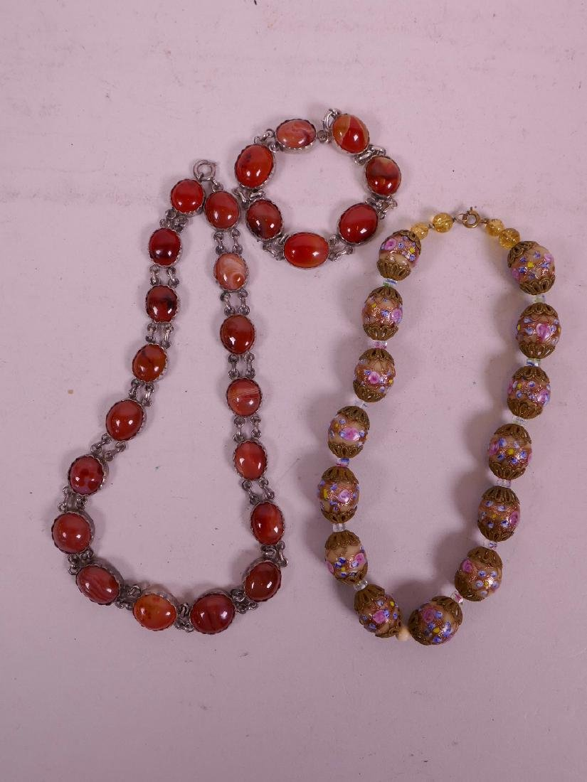 """An agate bead necklace with silver mounts, 17"""" long and"""