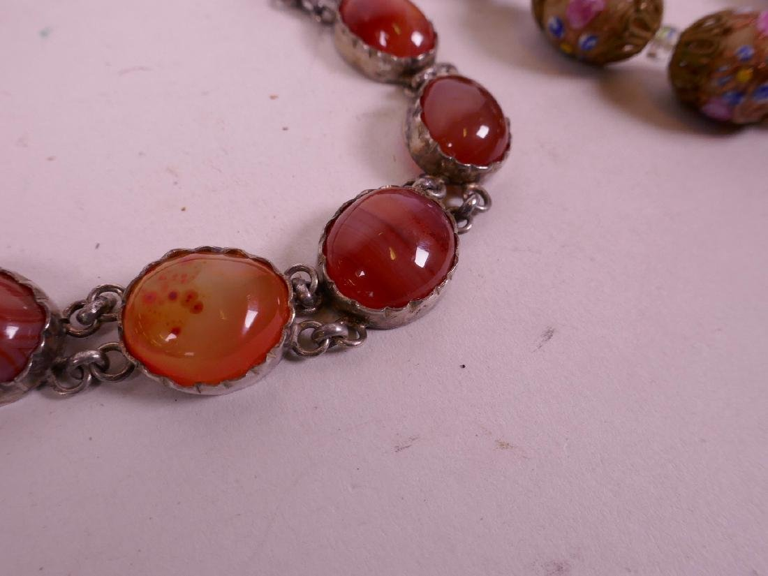 """An agate bead necklace with silver mounts, 17"""" long and - 2"""