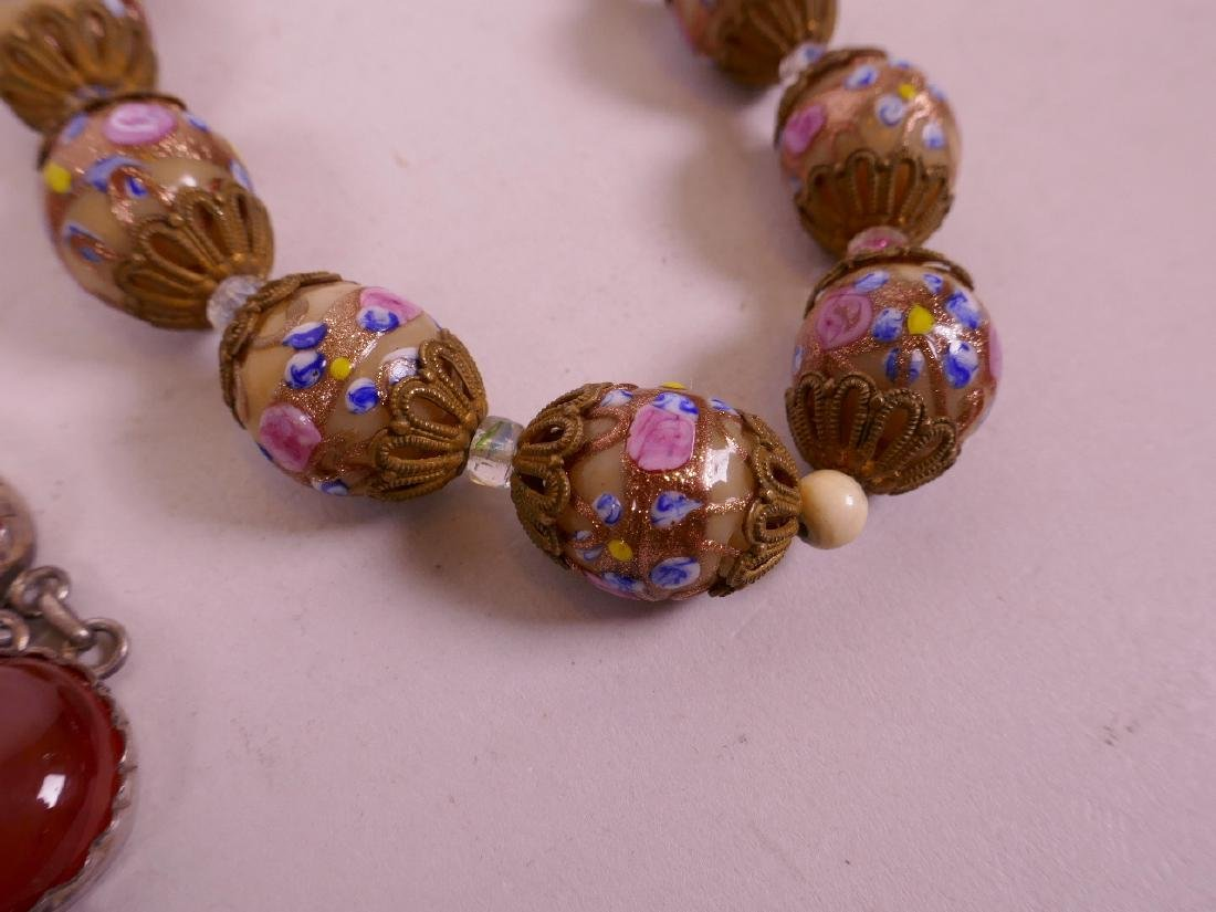 """An agate bead necklace with silver mounts, 17"""" long and - 3"""