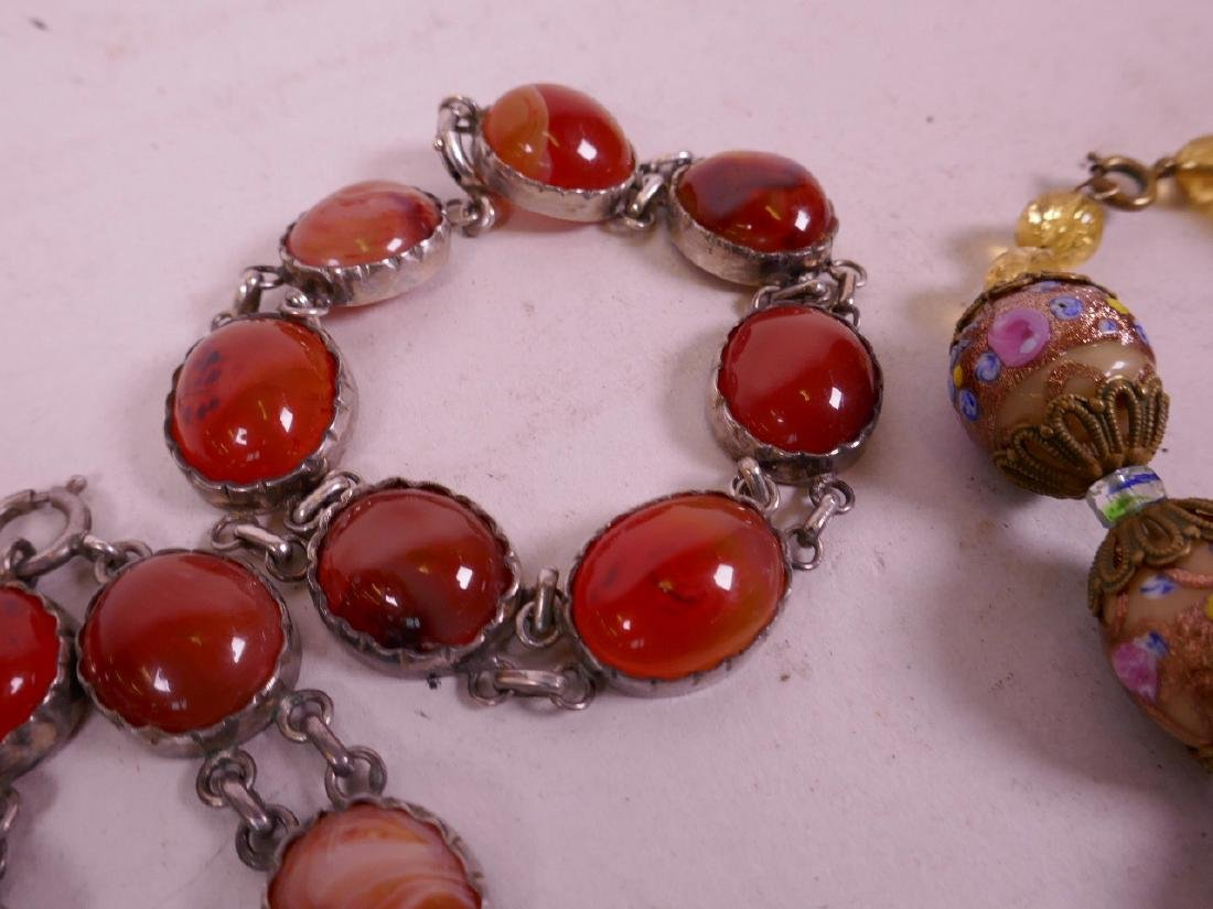 """An agate bead necklace with silver mounts, 17"""" long and - 4"""