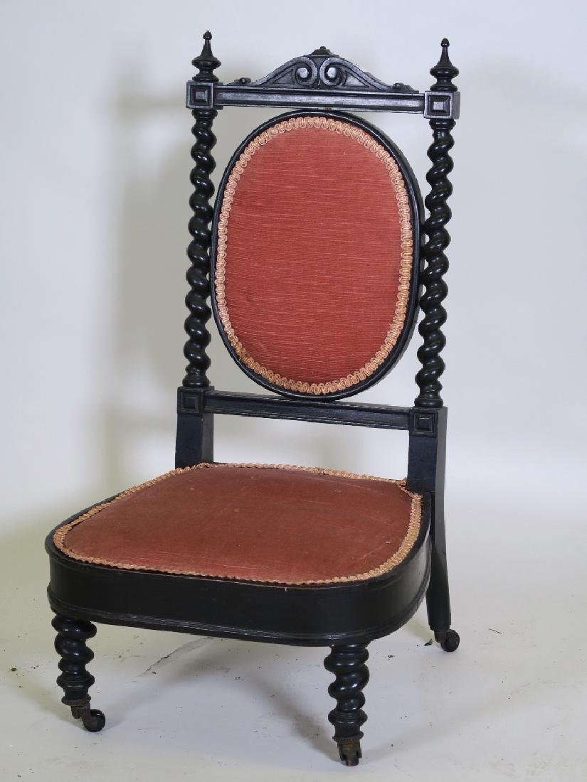 A C19th continental ebonised parlour chair, with carved