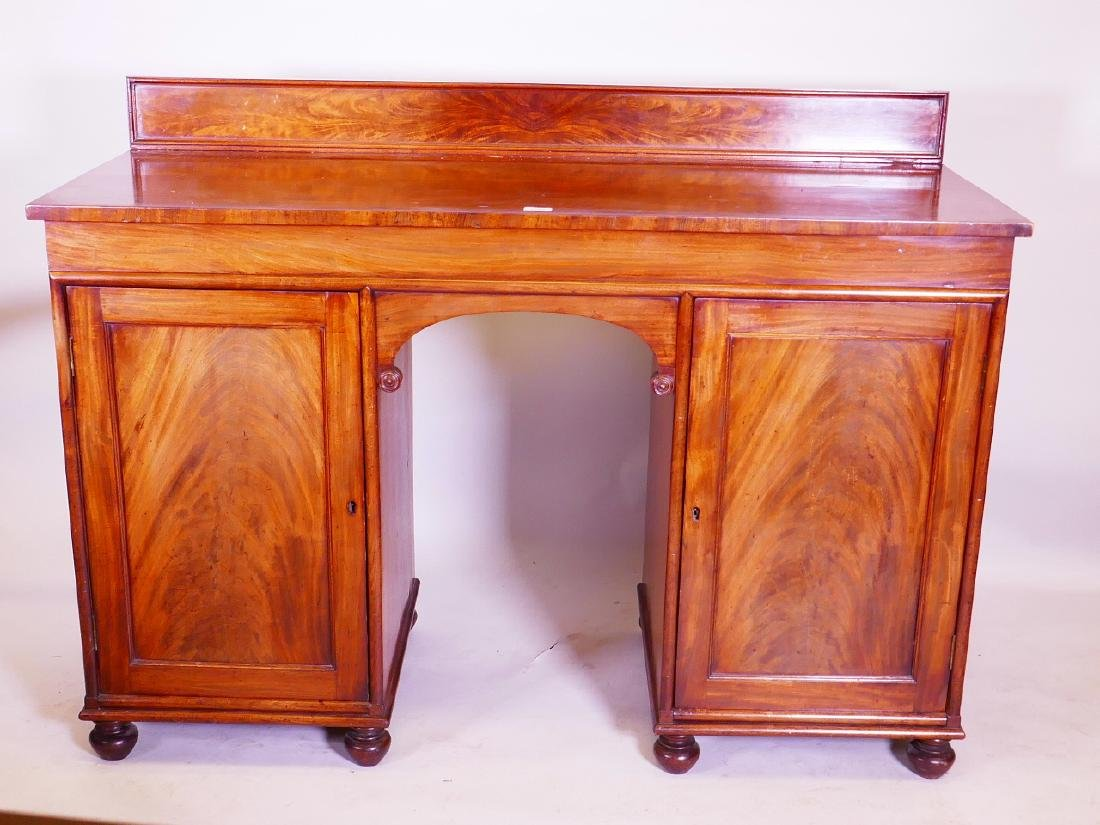 An early C19th mahogany sideboard, comprising two