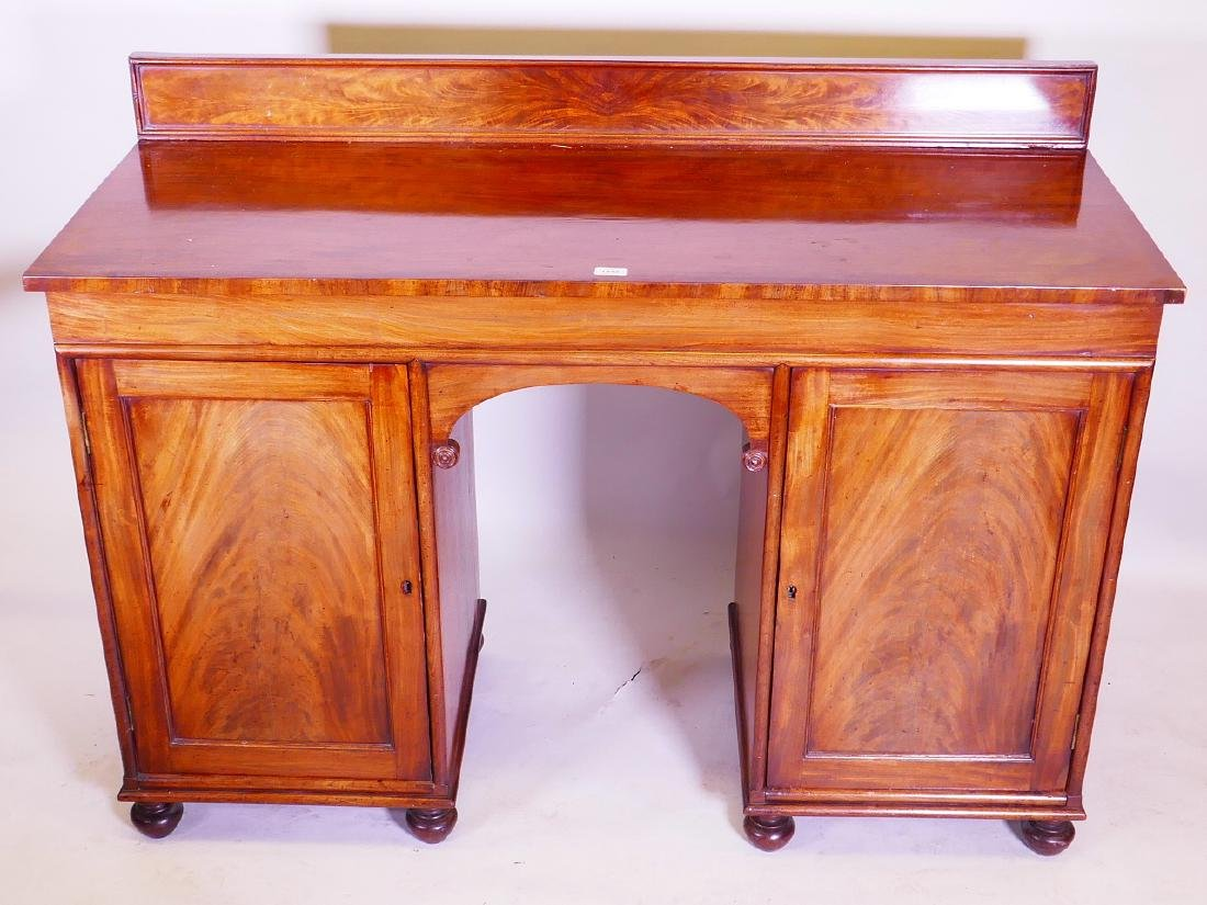 An early C19th mahogany sideboard, comprising two - 2
