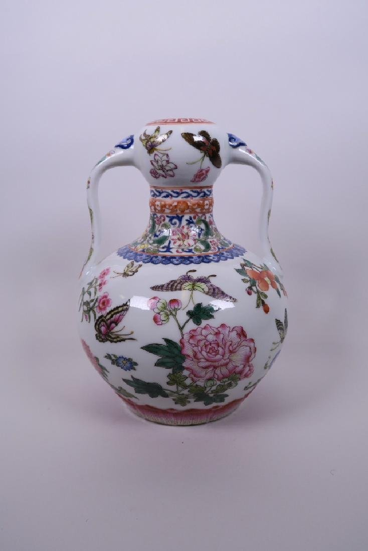 A Chinese polychrome porcelain garlic head shaped vase,
