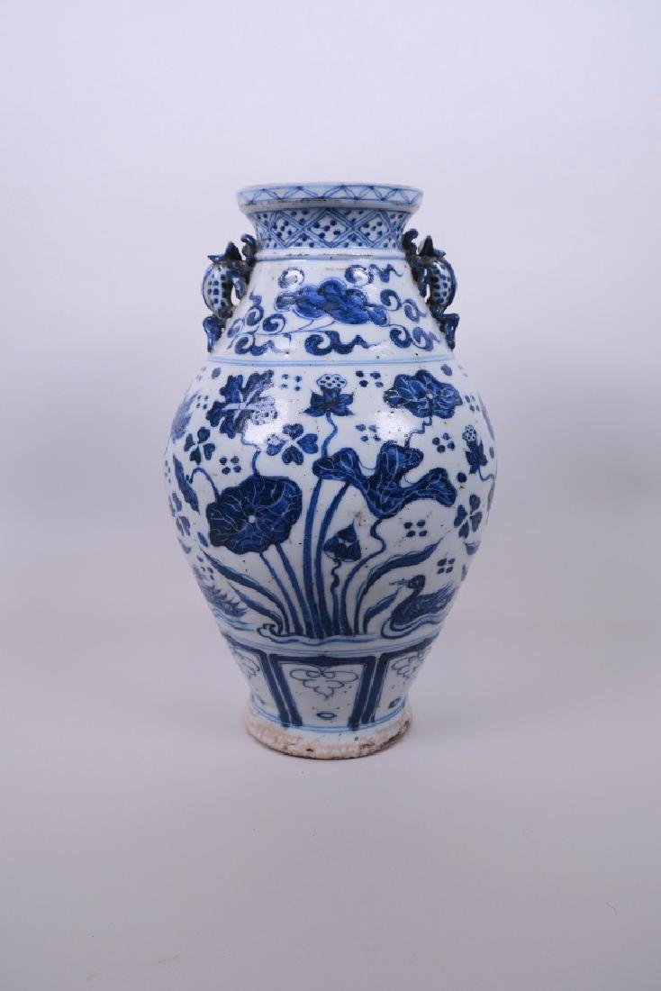 A Chinese Ming style blue and white pottery vase, with