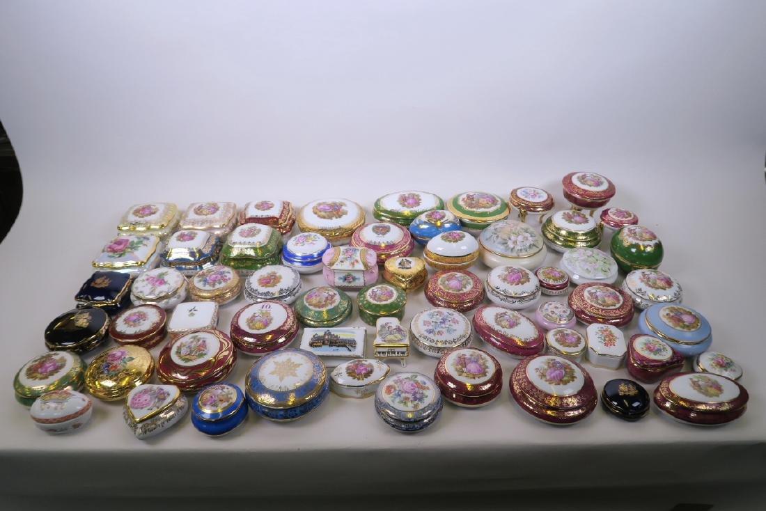 A large collection of Limoges porcelain trinket boxes,