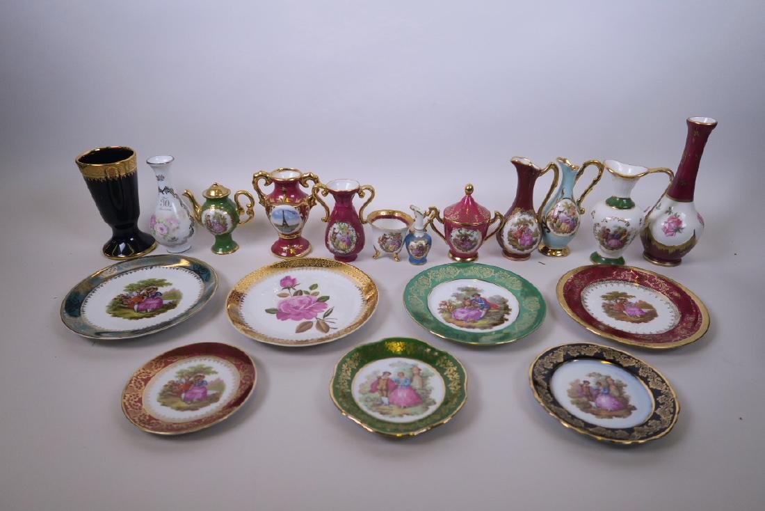 A quantity of Limoges porcelain to include small vases,