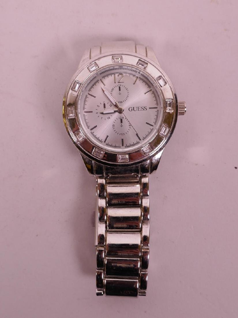 A Guess steel cased wristwatch, numbered 2151 verso,