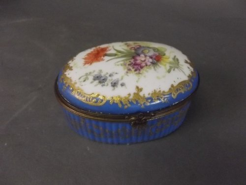 A C19th French blue ground oval trinket box painted