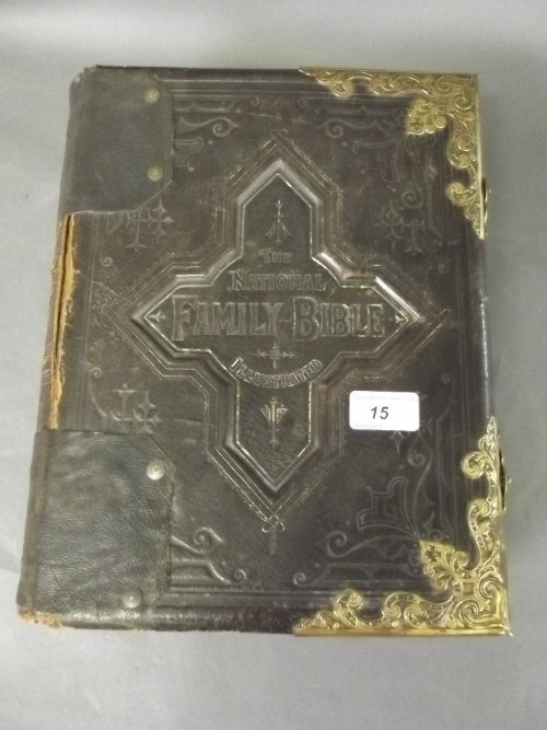 A Victorian brass bound leather Bible with plates by