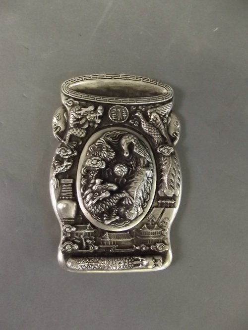 A Chinese silver coloured metal inkwell decorated with