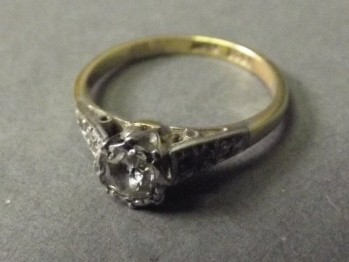 A 9ct gold solitaire diamond ring with diamond set