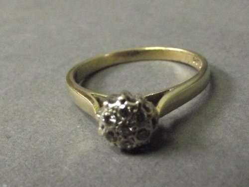 A 9ct gold 7 diamond set ring, size R