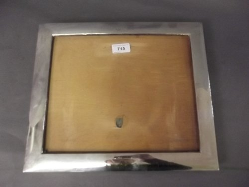 A large Hallmarked silver easel photo frame, Birmingham