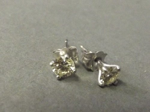 A pair of 18ct white gold and 0.6ct diamond ear studs