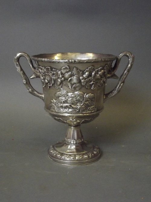 A good Hallmarked silver twin handled cup decorated