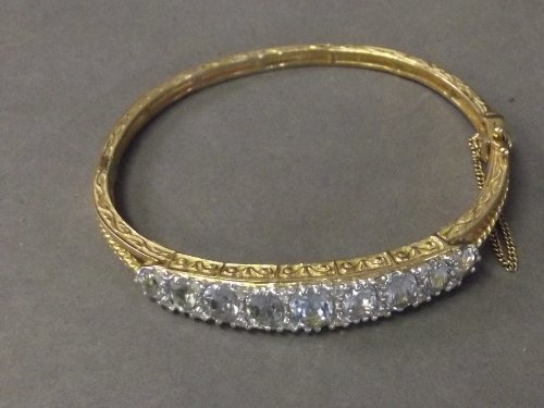 An 18ct gold diamond and aquamarine bangle