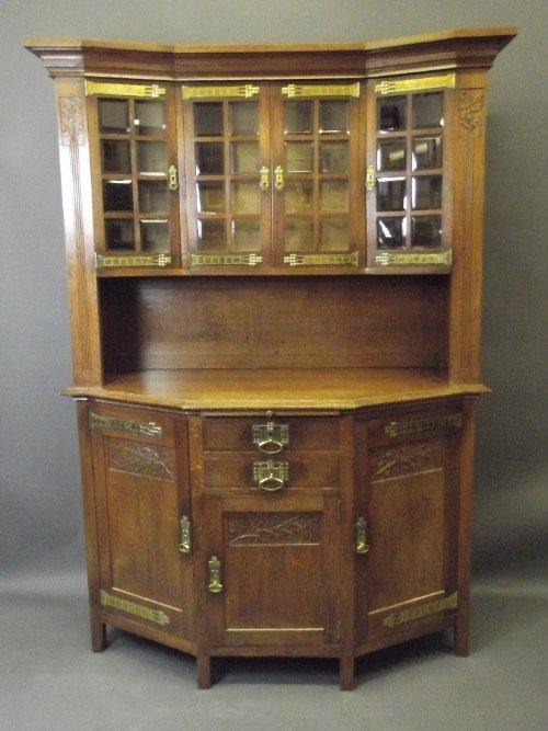 A good C19th Arts & Crafts oak sideboard of shaped