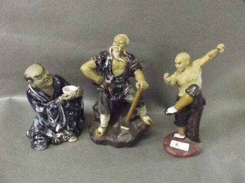Three large Chinese pottery figures with glazed decorat