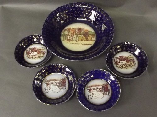 A large blue ground bowl with gold decoration to sides,