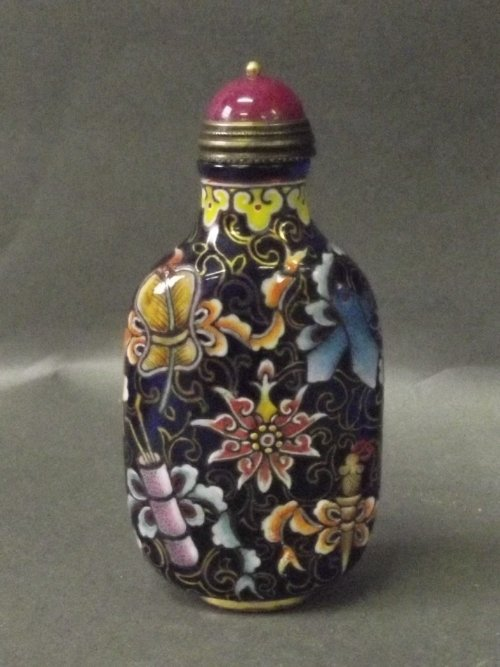 A blue glass snuff bottle painted with coloured flowers