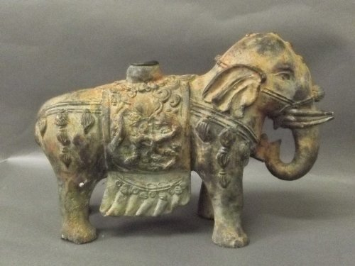A large bronze model of an elephant, 9½'' wide