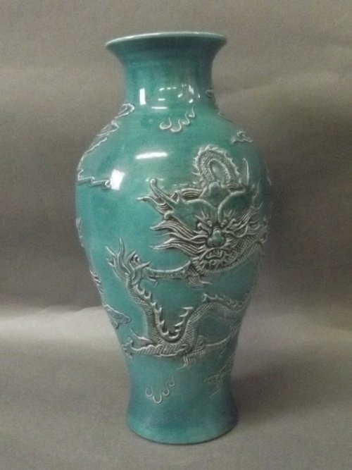 A Chinese turquoise ground vase with raised dragon deco