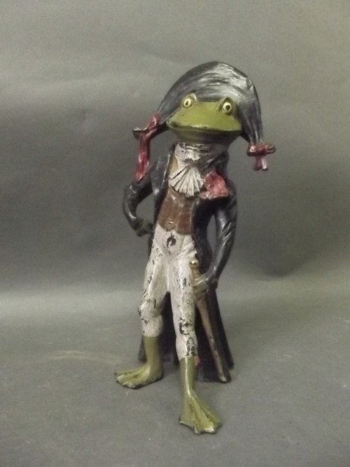 A cold painted bronze anthropomorphic frog dressed as N