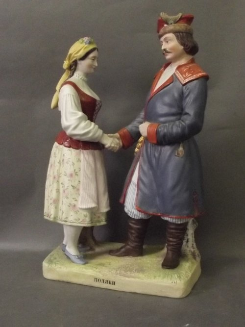 A fine Gardner porcelain figure-group of a lady and gen