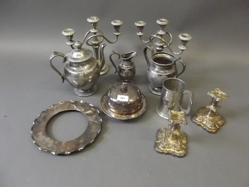 A quantity of silver plate to include candlesticks, jug