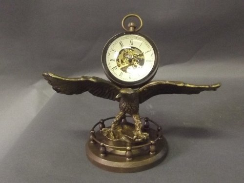 A bubble clock resting on the wings of an eagle, 5½'' h