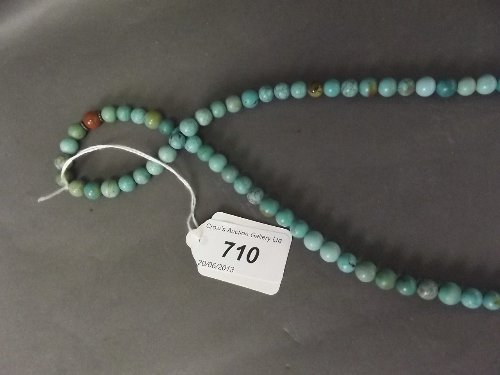 A long string of antique turquoise beads, 34''