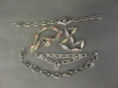 A quantity of silver bracelets (5), 7'' long