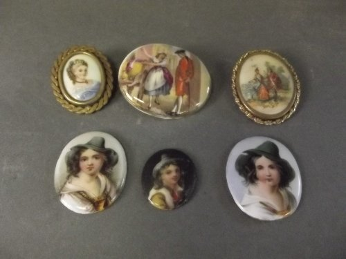 Three ceramic brooches decorated with classical figures